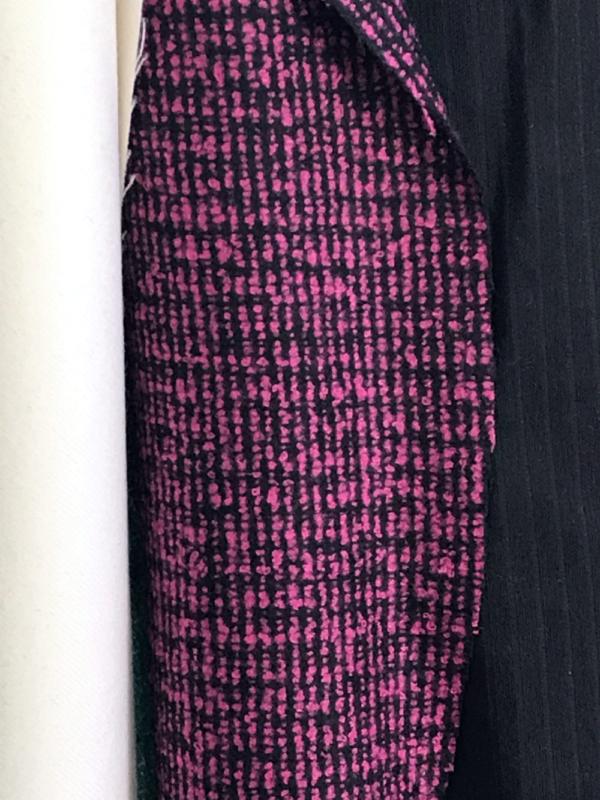 pink on black boucle tweed
