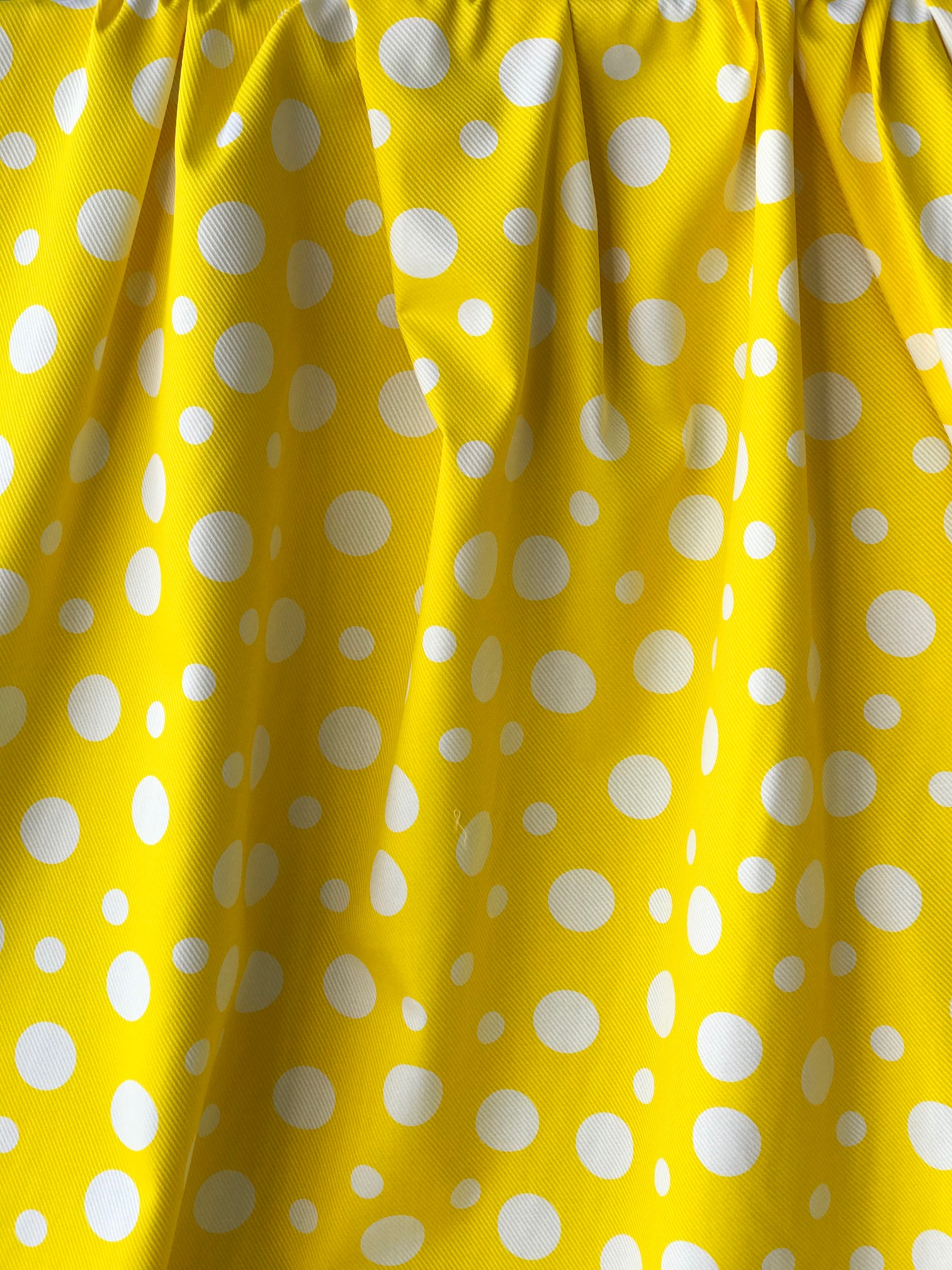white on yellow spots fabric