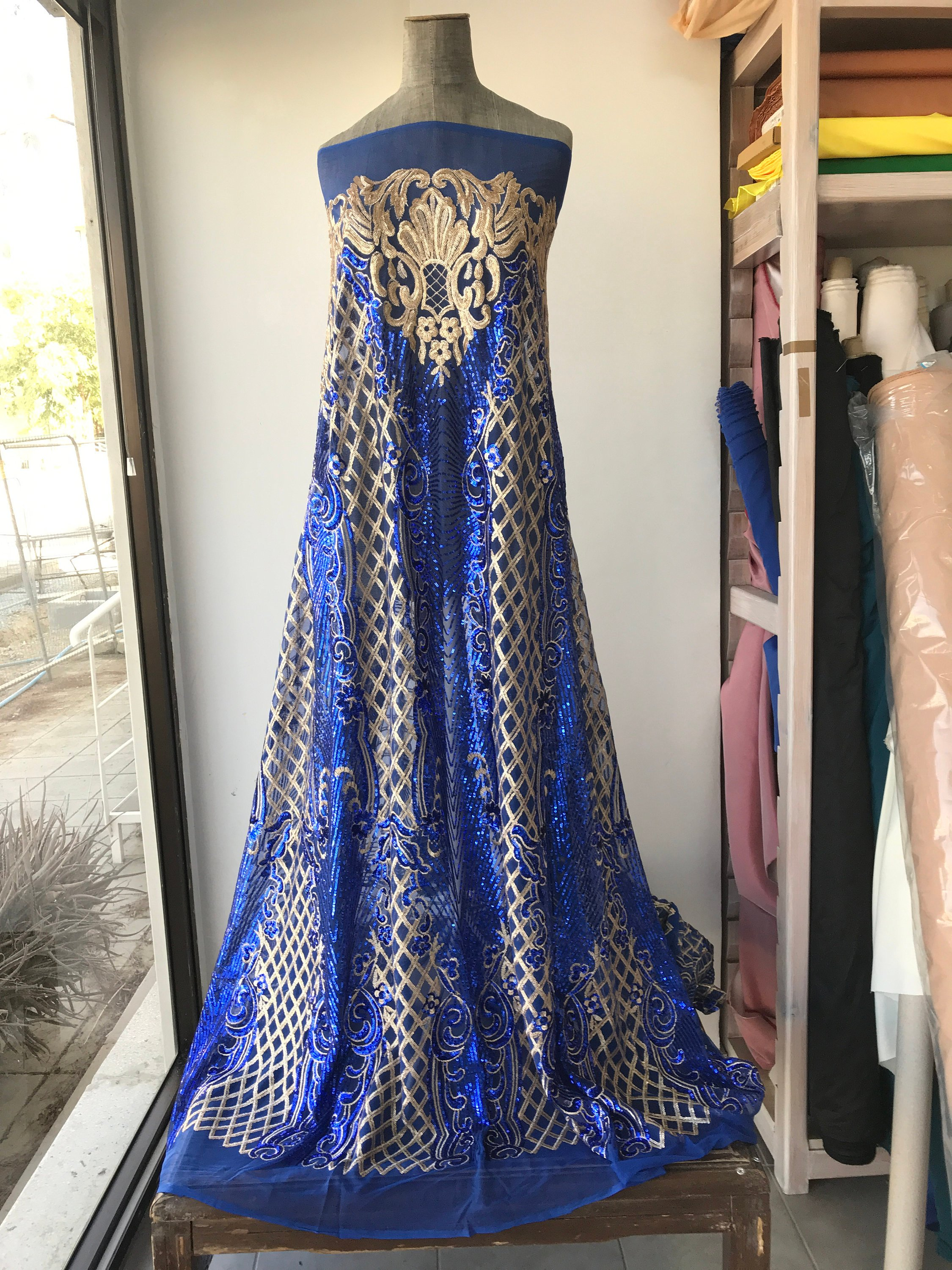 Gold on cobalt blue sequins