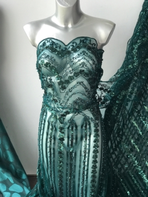 green beaded lace fabric